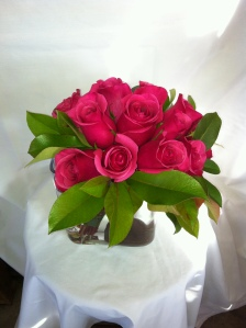 Bouquet of Love 99.95Rectangular vase designed with a dozen rose hand held bouquet anchored with rock focal point.