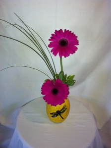 The every happy Gerber daisy in a keepsake dragonfly vase.  Very modern and cheerful - only 28.95.