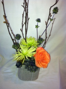 This design is all about texture - from the container design to the floral design.  A long lasting design for only 42.95
